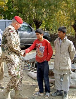 """General Egon Ramms with Afghan boys: """"The new counterinsurgency strategy is a population-centric one and defines the protection of the…"""