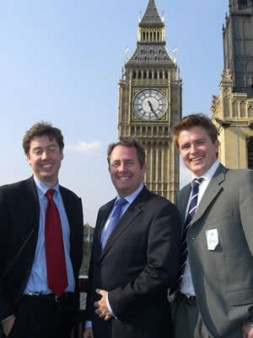 """Benedikt Franke and Ben Welch with Dr. Liam Fox: """"I do not want defence policy to fall as an European…"""