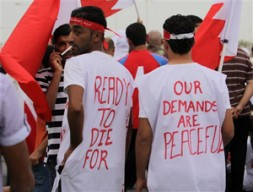 """Protesters in Bahrain in 2011. """"Arab hereditary rulers would be well advised to address key structural challenges such as promoting…"""