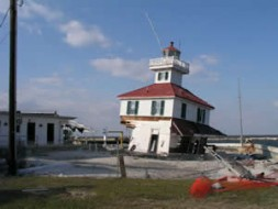 At the marina the hurricane pushed aside the lighthouse as if it was a gewgaw.