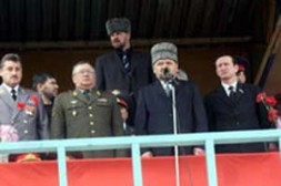 During the assassination of the President, Kadyrov Alkhanov was right near him. (First on the left.)