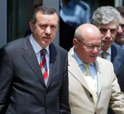 Turkish Prime Minister Tayyip Erdogan (L) accompanies Turkish Cypriot Prime Minister Mehmet Ali Talat (R) following their meeting at his…