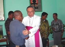 The Indonesian Bishop of Manado Mr. Suwatan greets the three convicted Catholics.