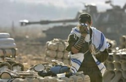 Power of prayer … an Israeli soldier at an artillery position in northern Israel pauses to pray.