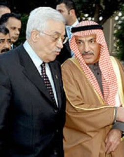 The P.L.O. chairman, Mahmoud Abbas, on Sunday with the Kuwaiti information minister, Muhammad Abu al-Hassan, right.