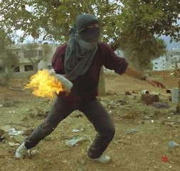 """A Palestinian fighter attacking with the so-called """"Molotow cocktail"""""""