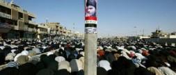 A poster of the Shiite cleric Moktada al-Sadr on display during Friday Prayer recently in Sadr City, a Baghdad slum…