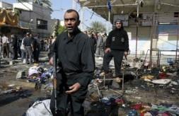 Mahdi militiamen in the rubble of a Nov. 12 bombing in Baghdad.