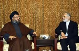 Hizbullah's leader, Sheikh Hassan Nasrollah, meets with Iranian Foreign Minister Kamal Kharrazi in Hizbullah's Beirut headquarters, May 26, 2005.