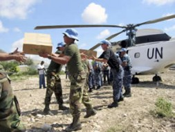 Humanitarian aid is disembarked from a United Nations helicopter.