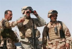 An Iraqi soldier, left, helps to identify a location to a U.S. soldier,center, outside Samarra, Iraq.